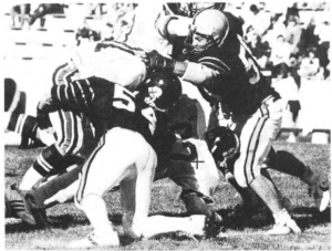 Noseguard Jim Petrucci and teammate Lorne Keller stuff the Brown running back.